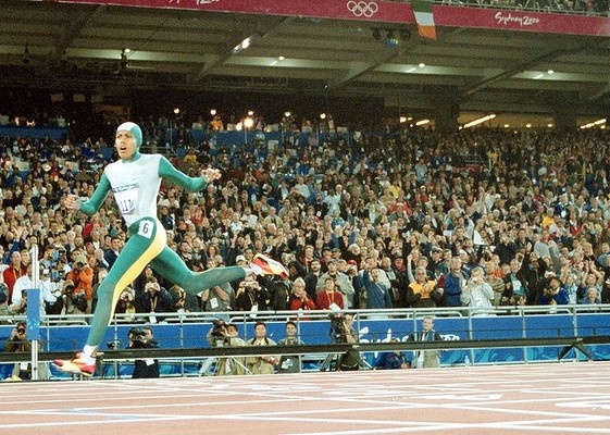 Triumph: Cathy Freeman crosses the line to win gold at the Sydney 2000 Olympics.    SHE'S DONE IT!