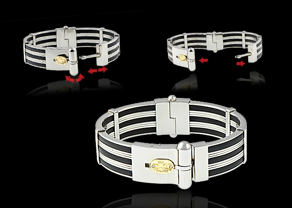 445.00  Repin Edit    Stainless steel and black rubber bracelet with 18k yellow gold and diamond Sauro logo.