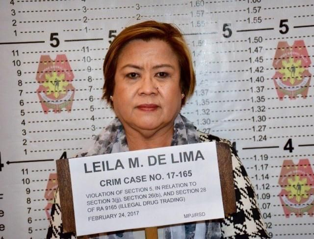 "The Philippine National Police (PNP)took Senator Leila De Lima's mugshots at Camp Crame following her arrest at the Senate on Friday, February, 24, 2017. The lady senator was arrested on drug charges related to the alleged drug trade at the New Bilibid Prison. Before the order of her arrest, De Lima said she's innocent and denied the charges in a recorded video posted on Facebook. ""Clearly, this administration has evil and dangerous plans: to make an example of me to intimidate, silence…"