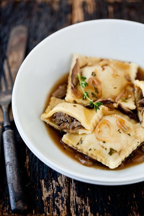 Braised lamb ravioli with shitake parsley broth