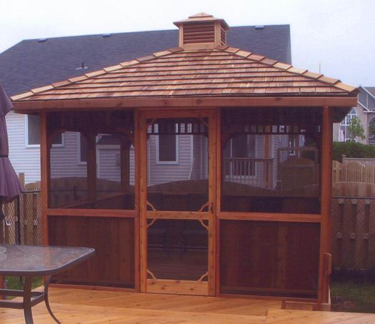 A Screened Square Gazebo Kit With An Added Cupola Keeps