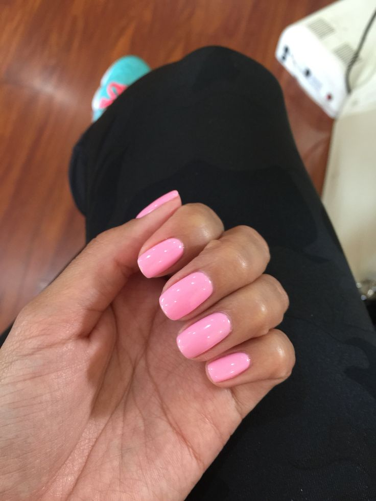 Carnation pink shellac nails are always a favorite.