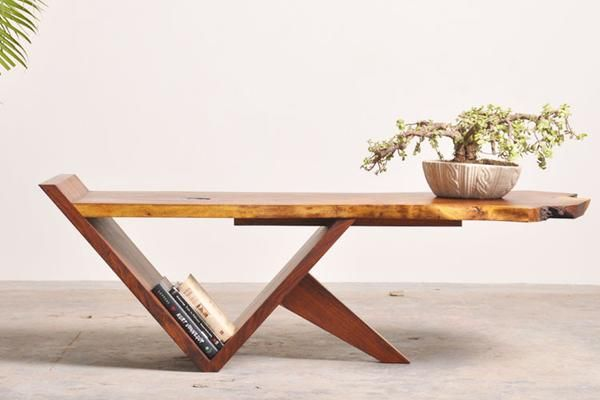 Coffee table made from a single slab of amber hued Rosewood slab. Clean geometric lines of base design merged seamlessly with the top live edge slab.