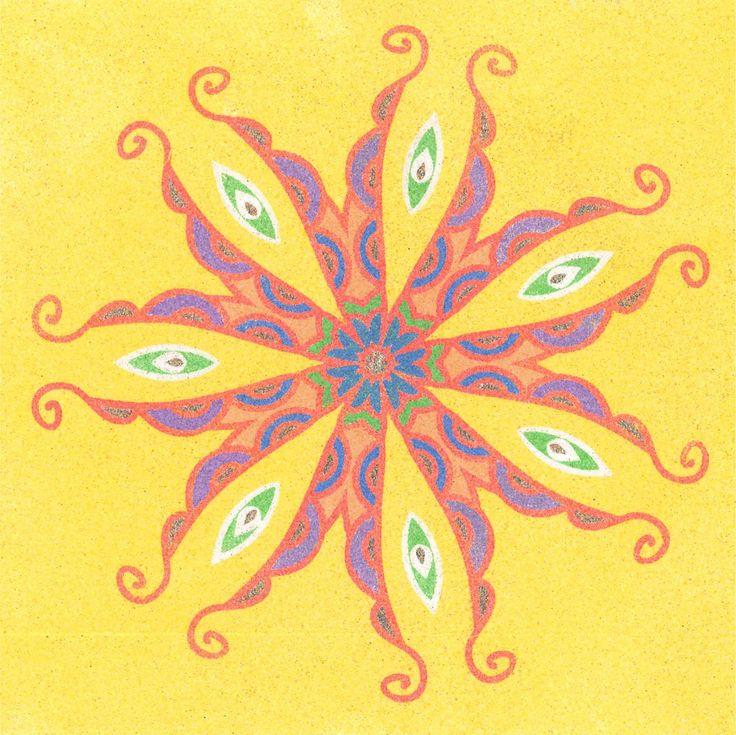 Vypískovaná mandala barevným pískem