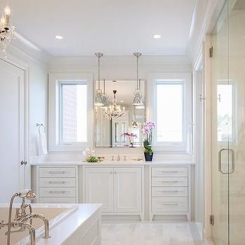 All White Master Bathroom with Chandelier Over Tub, Transitional, Bathroom