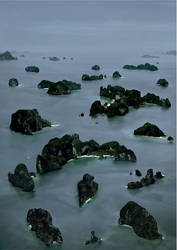 James Bond Island III, 2007.  Andreas Gursky. I love the rhythm in this photo. The effect of the rhythm of the rocks in the image really helps your eyes jump from the foreground into the background in a cross to cross pattern. Also the organic shapes of the rocks create interest. The composition implies beauty in the world around us, and how dark the natural world can be.