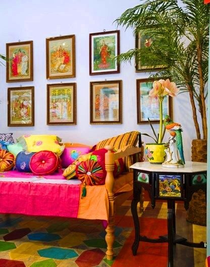 Indian decor. Love the pillows and the wall art.