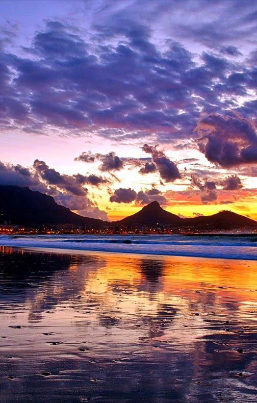 Cape Town, Table Mountain One of the seven new wonders of nature visited by more than 800,000 visitors annually via cable car.