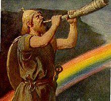 I nordisk mytologi er Bifrost regnbuen. Det er broen der forbinder Asgård, hvor guderne bor, med Midgård, hvor menneskene bor. På toppen af Bifrost ligger Himmelbjerget, hvor asen Heimdall bor. Han kan se græsset gro, og høre ulden vokse på fåret. Bifrost skal efter sigende slå revner, og gå til grunde ved Ragnarok, når ildjætten Surt – konge af Muspelheim – og hans hær krydser den.  Foto: Afbildning af Heimdal der står foran Bifrost, (1905) af Emil Doepler.