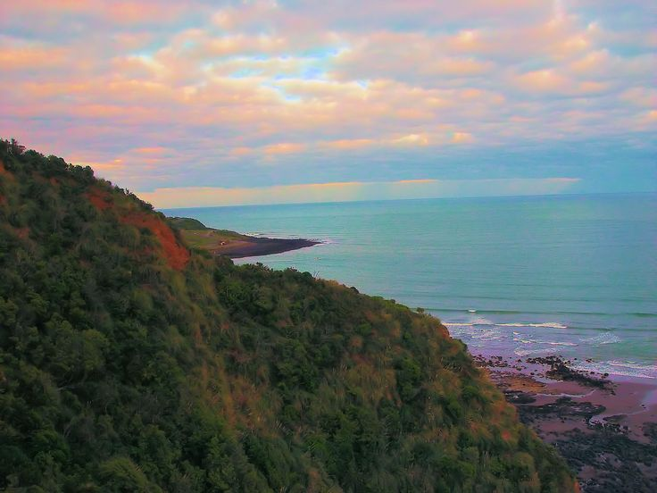 looking out over the beach near Raglan, NZ, at sunrise.