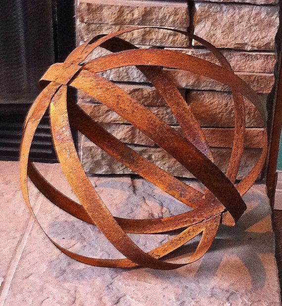 This sphere is 15 inches tall and flexible almost bouncy. It is made of rusty sheet metal and is a unique piece to place in a corner in your home,