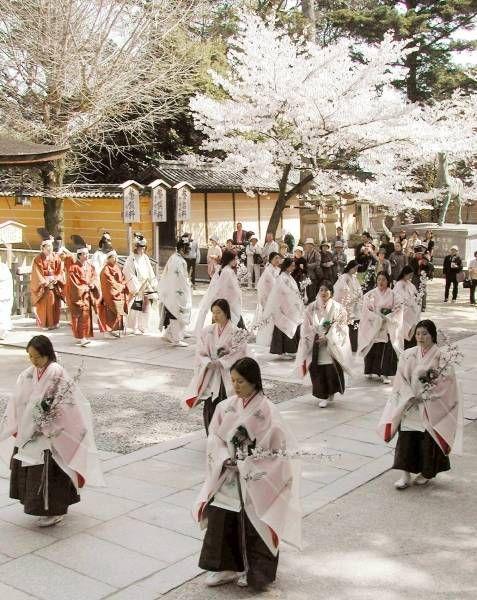 Japanese female attendants at shrine -miko-
