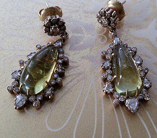 Burmese cabochon Chrysoberyl 22.24cts & diamond 2.16cts earrings.