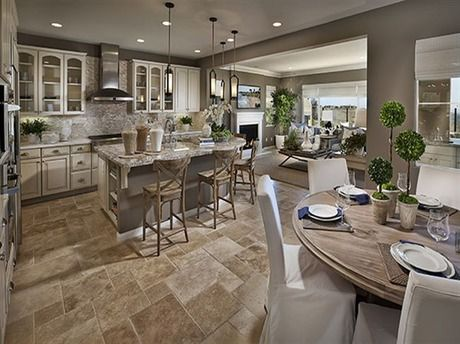 An elegant cream and tan palette links this kitchen and great room. New homes in Fairbrook Estates by Ryland Homes in San Diego, CA.