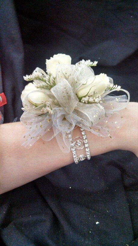 Wrist corsage. I like the idea of building it on a bracelet.