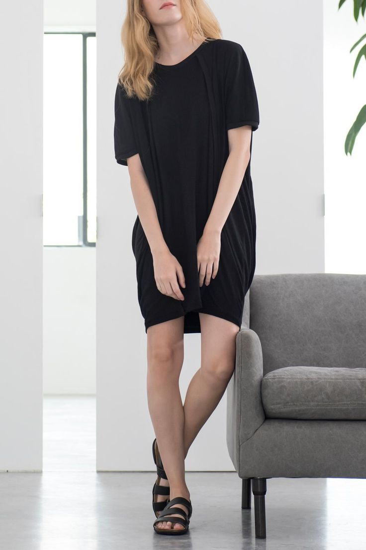 "Loose and comfortable long shirt, ellipse shaped, with folds on the back neckline. The shirt is made of two different fabrics, the fabric on the sides and sleeves is slightly thinner and slightly transparent. The fabric in the middle (front & back) more opaque. The curvy cuts are ""marked"" with black reeve strips, giving the shirt a constructed feel and style.   Ellipse Big Shirt by Magpie Goose. Clothing - Dresses - Casual Tel Aviv, Israel"