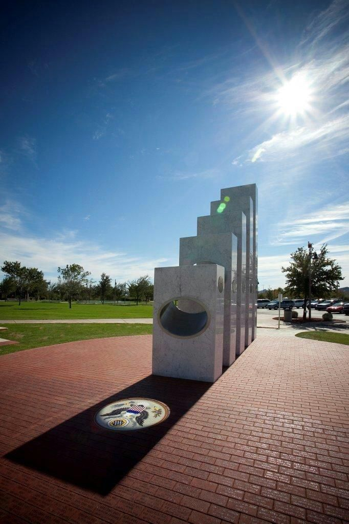 The Anthem Veterans Memorial in Anthem, Arizona features five pillars representing each branch of the United States Armed Forces. On one day only, Veterans Day, they are all perfectly aligned to spotlight a mosaic of the Great Seal of the United States.