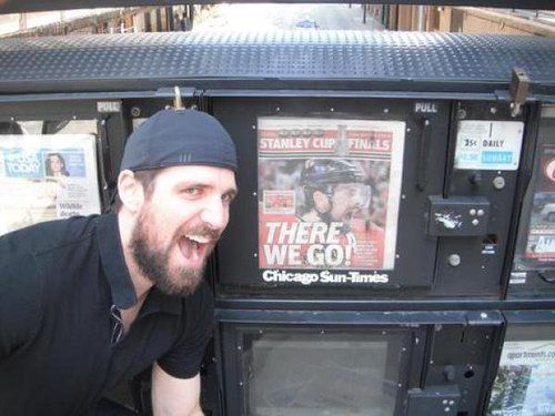Patrick Sharp reenacting the cover photo from the Chicago-Sun Times.
