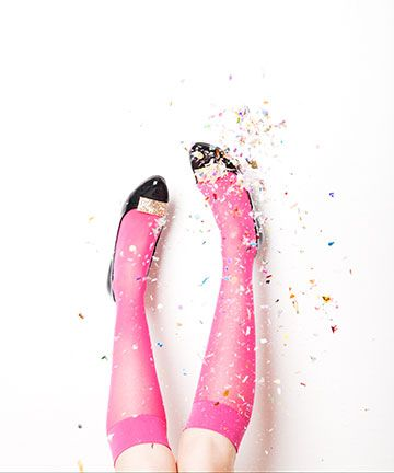 Love the plain black pumps with the bright neon pink knee high socks