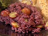 Red Wine Rice with Grapes: 1 3/4 cups dry red wine, 1 fresh bay leaf, 1 Tbsp. extra-virgin olive oil, 1 cup white rice, 1 cup red or black seedless grapes