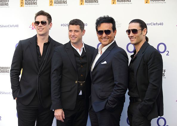 David Miller Sebastien Izambard Carlos Marin and Urs Buhler of Il Divo attend the Nordoff Robbins O2 Silver Clef Awards at The Grosvenor House Hotel...