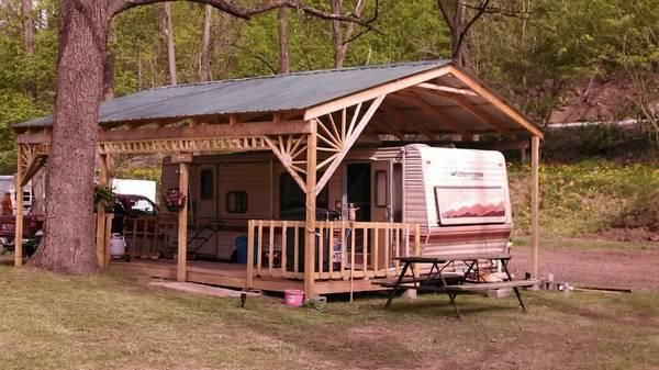 Camper with porch be sure horse trailer and truck fit for Rv shed ideas