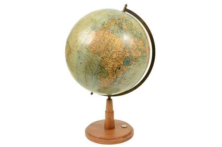 Globe DURCH THE WELT by the cartographer Peter Oestergaard published in Berlin in the thirties. Turned wooden base complete with compass and engraved brass meridian circle. Very good condition. Height 52 cm, diameter of sphere 30 cm.