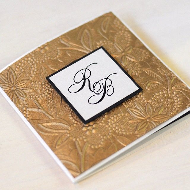 This handmade gold embossed paper makes such a luxurious invite. Paired with classy fonts and classic pearlescent white and textured black, this pocket invite proves that sometimes more is more! www.thepaperempire.com.au