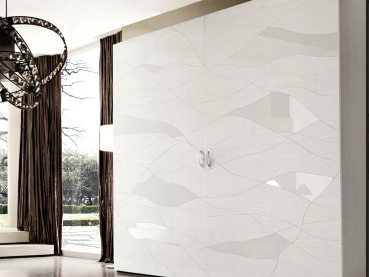 A white wardrobe by Benedetti. Interesting design and texture.