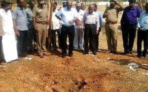 Indian authorities inspect the site of a suspected meteorite landing on February 7, 2016 in Vellore district in southern Tamil Nadu state in an impact that killed a bus driver and injured three others on February 6. If proven, it would be the first such death in recorded history. The impact of the object left a large crater in the ground and shattered window panes in a nearby building, killing the driver who was walking past. Picture: AFP.