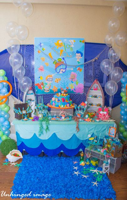 Under Water Bubble Guppies scalloped table cloths. Use a pizza pan to trace scallops.