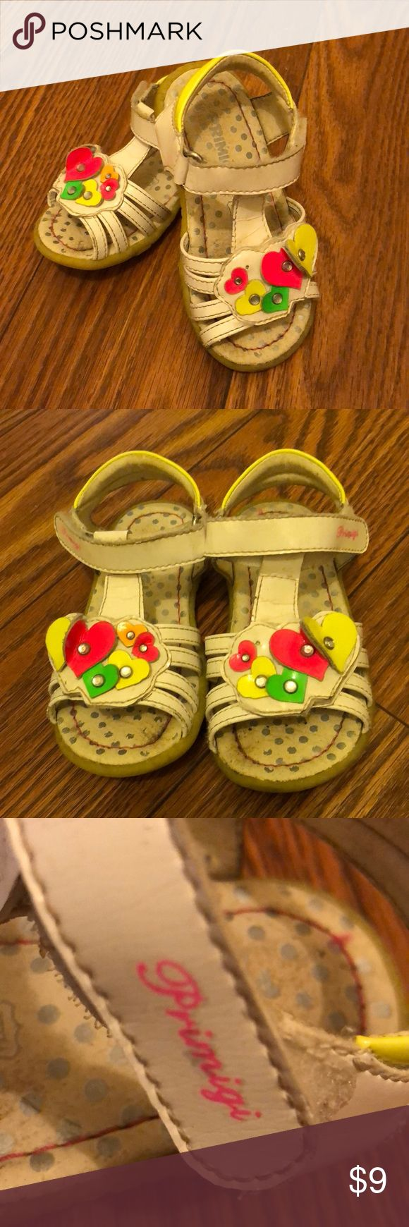 Cute Primigi Sandals Bright colors and fully adjustable straps make these sandals a winner. They are in good working condition with some wear on the footbed and soles. Some minor fraying around the straps, and minor cracking in the patent leather. Primigi Shoes Sandals & Flip Flops