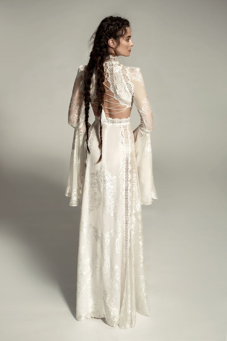Gorge! Meital Zano Hareli 2017... Back view of a chic boho dress made of soft silk fabric with sparkling designs. The dress has full bell sleeves integrated with lace ribbons along the length. A closed golf dress with cut-outs at the waist area and an open back. MZ1702