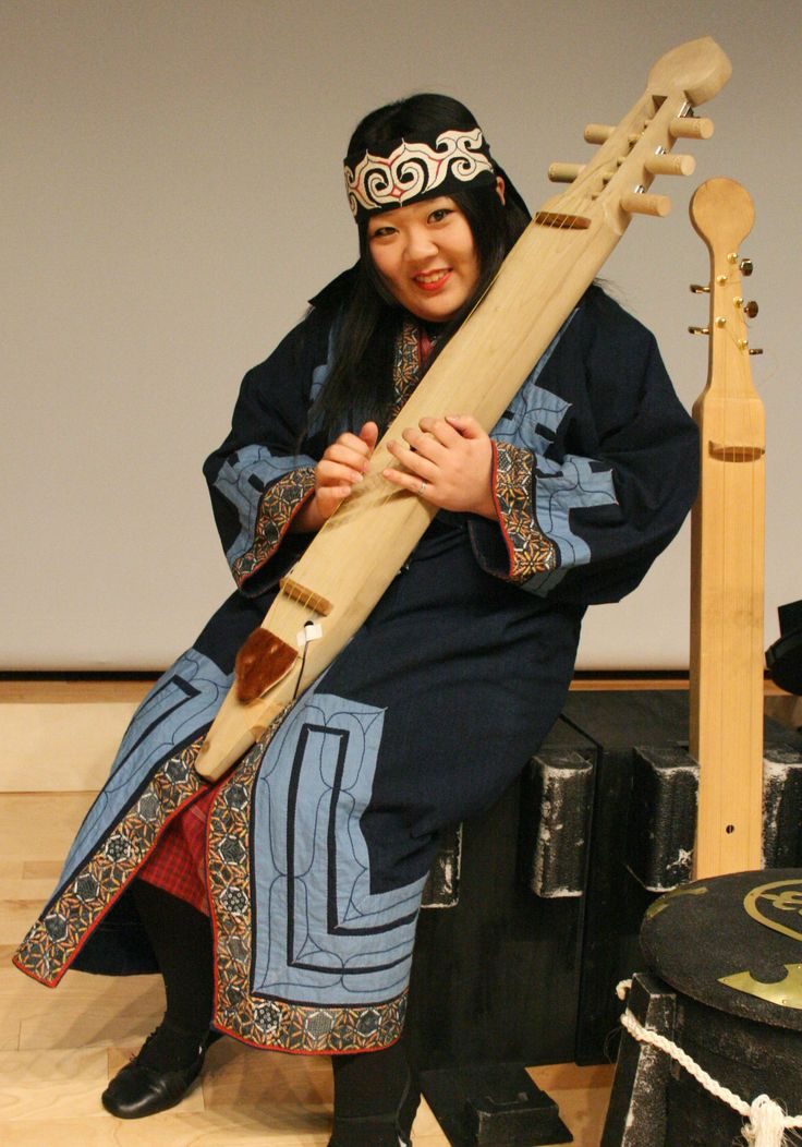 Ainu dance performer Ayaka Ono holds the stringed 'tonkori,' one of the indigenous ethnic group's traditional musical instruments.
