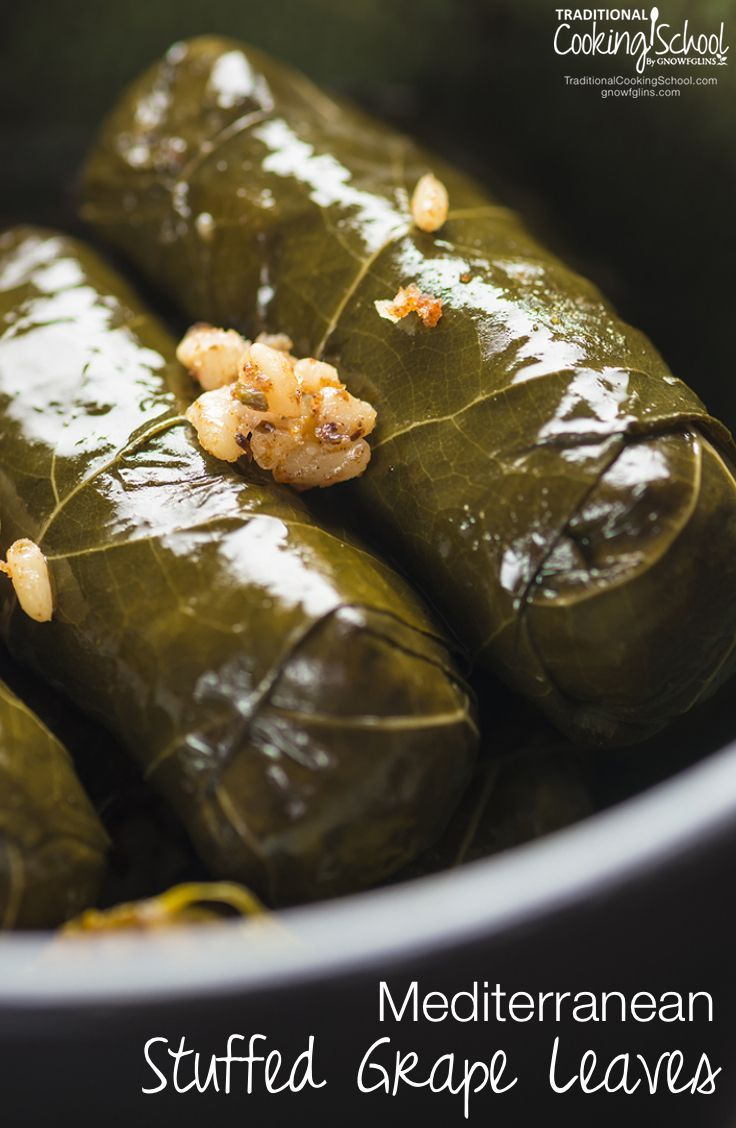 Mediterranean Stuffed Grape Leaves {Dolmas} | Stuffed grape leaves are one of my all-time favorite foods. When we had them growing up, it was a family affair. Whoever was home loved to get in on the rolling. My mom would lead us in making a huge pot of them. We would eat off them for days, if they lasted that long! | TraditionalCookingSchool.com