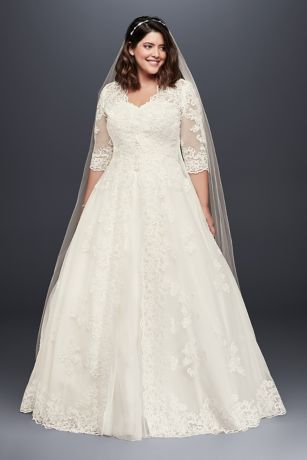 This gorgeous plus-size ball gown features a lace-appliqued strapless bodice and... 1