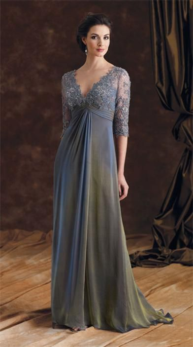 An iridescent blue silk chiffon gown is graced with shimmering hand-beaded lace, a pleated empire waist and sweeping train.