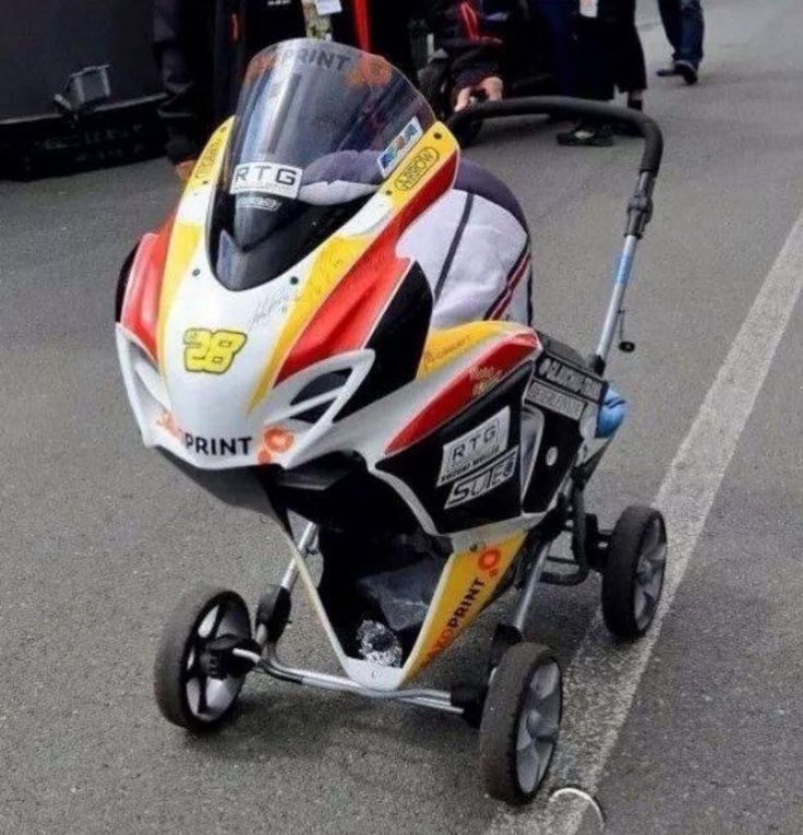 This baby carriage was spotted at The Isle of Man TT races. Absolutely brilliant.