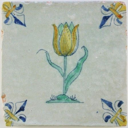 Antique Dutch Delft wall tile with a wonderful tulip colored yellow and orange, 17th century