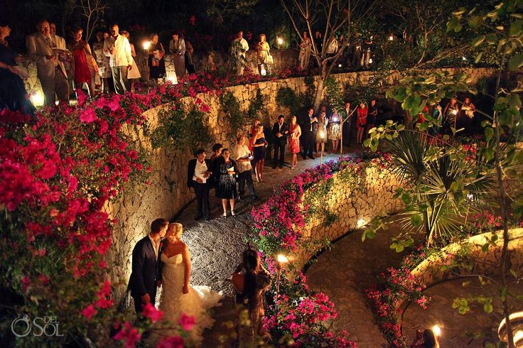Bride and Groom walk through the caracol on their wedding night at Xcaret Park Riviera Maya Mexico