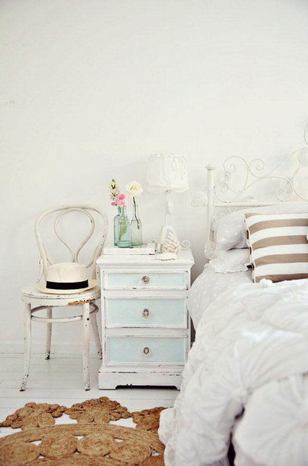 White Walls and Light Hardwood Floors Shabby Chic Bedroom.