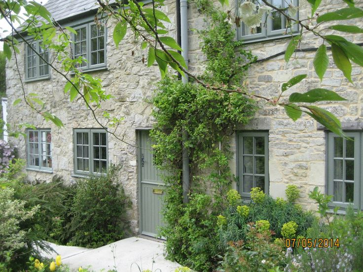 RAL 7033 PVCu Windows with Surface Adhered Georgian Bars for that traditional…