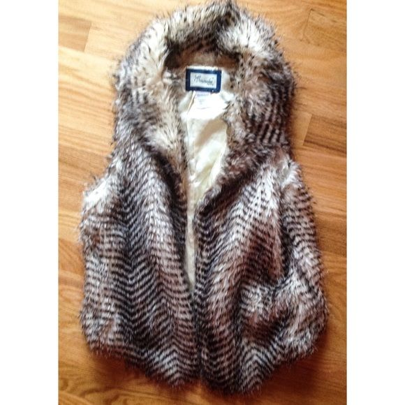Faux Fur Neutral Vest This vest has beautiful natural colors and soft long faux fur you won't believe it's not real! A classy longer front, the drape and shawl collar are great stand-out details. A perfect neutral accent to any outfit! Francesca's Collections Jackets & Coats Vests