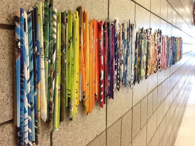 A wave of color and rhythm - I might have made the rolls undulate to create more movement. [Art at Becker Middle School: Magazine roll rhythm]
