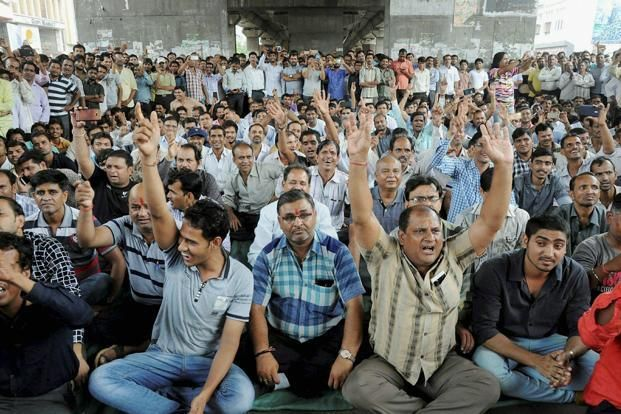 Textile traders during a protest against Goods and Services Tax (GST) in Surat on Thursday. Photo: PTI