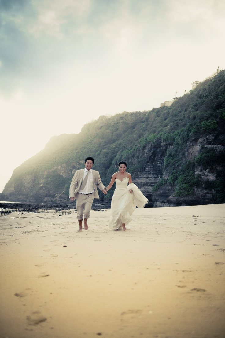 Weddings | Sienny & Joko take a walk on the beach before the party gets going at Karma Kandara, Nammos Beach Club. Bali.