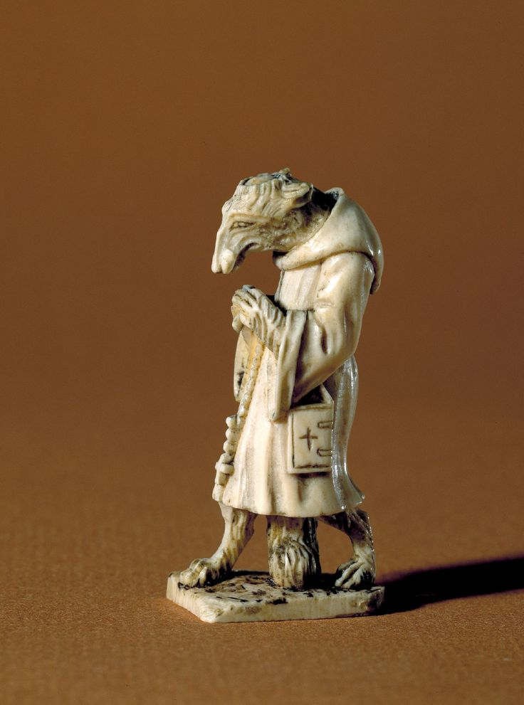 Fox in a monk costume. Ivory figure, 6 cm tall. Dated to the time of the Reformantion in Denmark. 1530