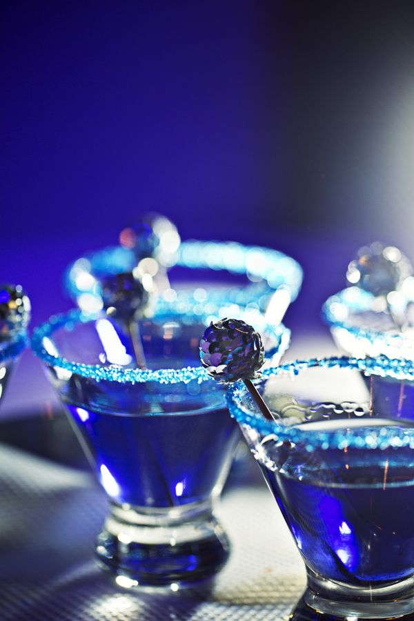 'Sparkle Bomb' - wedding signature drink: pomegranate vodka, orange liqueur, pomegrante juice, lime twist, with a sparkling sugar rim. http://www.theperfectpalette.com/2014/02/real-wedding-tara-spencer.html