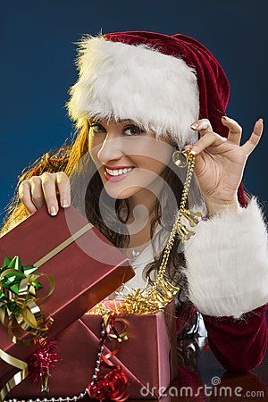 Portrait of beautiful smiling woman in Santa Claus costume opening a gift box and ringing decorative Christmas bells over blue background. Download Merry Christmas! Stock Photography for free or as low as 0.69 lei. New users enjoy 60% OFF. 20,057,919 high-resolution stock photos and vector illustrations. Image: 35417102