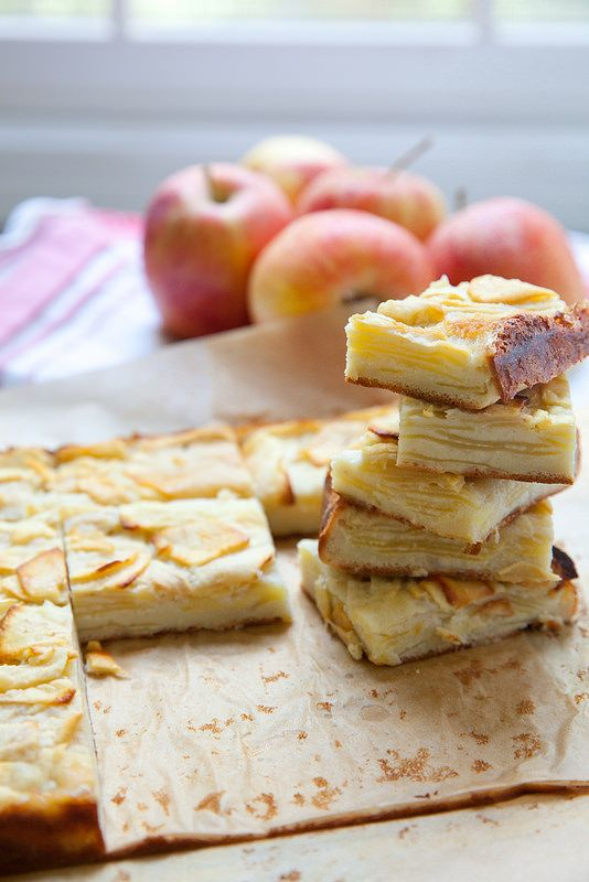 Apple Custard Bars: 3 medium apples, such as gala or pink lady, peeled, ½ cup all-purpose flour, 1 tsp. baking powder, ½ tsp. ground cinnamon, ¼ tsp. grated nutmeg, 2 large eggs,1/3 cup sugar, pinch of coarse salt, 2 tsp. vanilla extract, 6 tbsp. whole milk, 2 tbsp. unsalted butter, melted and slightly cooled.